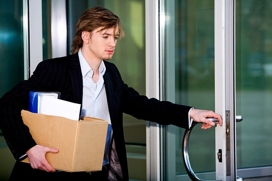 bigstock_Unemployed_Young_Manager_Leavi_3848584